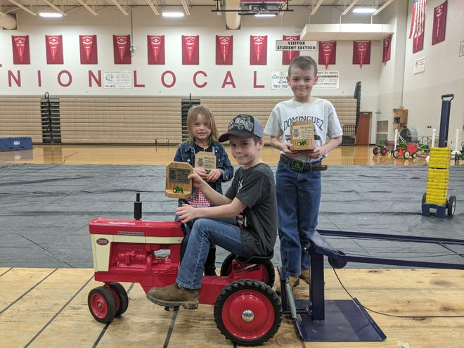 Kiddy Pedal Pull winners were, l to r, Abigail Bugay, JR Kreggar, and Bowden Dominguez.