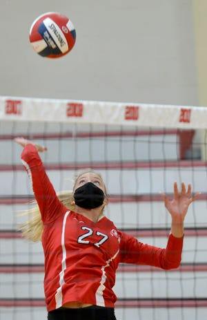 """Barnstable's Caroline Kiehnau returns a ball against Dennis-Yarmouth during their match Tuesday in Hyannis.  The Georgia transplant was looking for a good school to play volleyball. """"I am banking on playing volleyball in college and Barnstable is the best around, so I figured I should play here,"""" she said."""