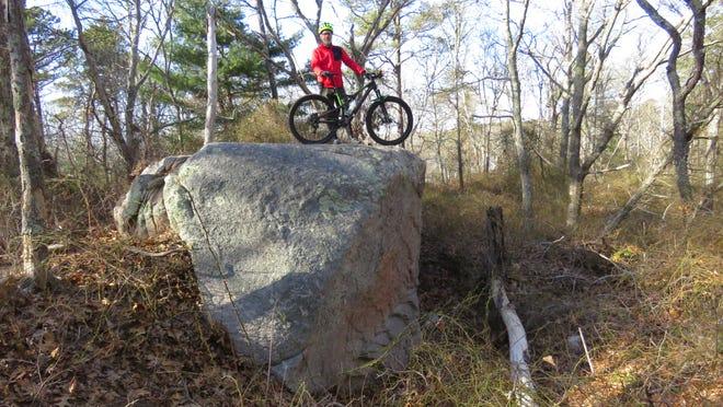 My biking guide, Lev Malakhoff atop a giant boulder.