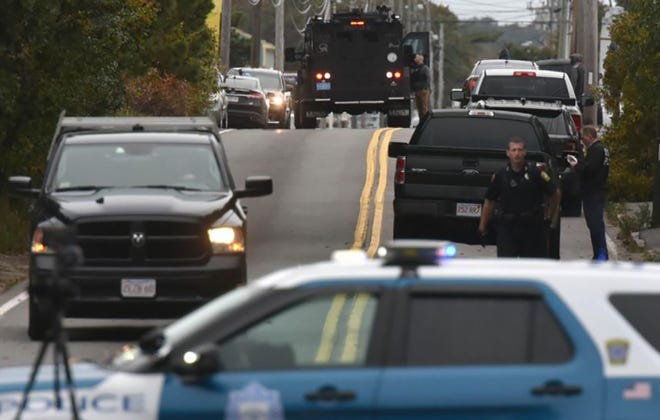 Police and SWAT vehicles fill the road as they investigate the area of a fatal shooting on Yarmouth Road in Hyannis, Oct. 16, 2019.