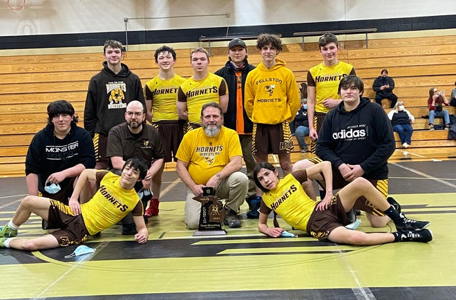 The Pellston wrestling team captured its first-ever district championship after a 42-27 victory over St. Ignace in a Division 4 championship match held in St. Ignace on Wednesday. The Hornets are coached by Ken Crawford and Albert Bettis.