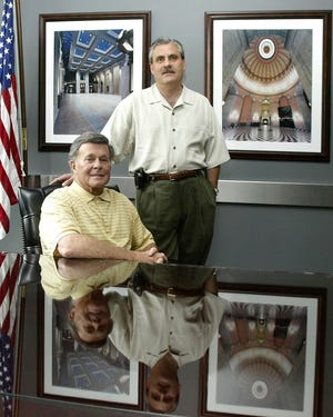 Paul Tipps, left, and Neil Clark, in their Columbus office in 2004. Clark, a longtime Ohio lobbyist who had pleaded not guilty in a sweeping federal bribery investigation, was found dead March 15 near his home in Florida.