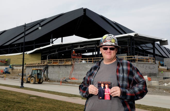 Construction worker Dennis Herman wrote a message honoring his late mother on the north end of the new Crew Stadium in Downtown Columbus.