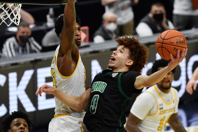 Mar 11, 2021; Cleveland, Ohio, USA; Ohio Bobcats guard Jason Preston (0) drives to the basket against Kent State Golden Flashes forward Justyn Hamilton (21) during the second half at Rocket Mortgage FieldHouse. Mandatory Credit: Ken Blaze-USA TODAY Sports