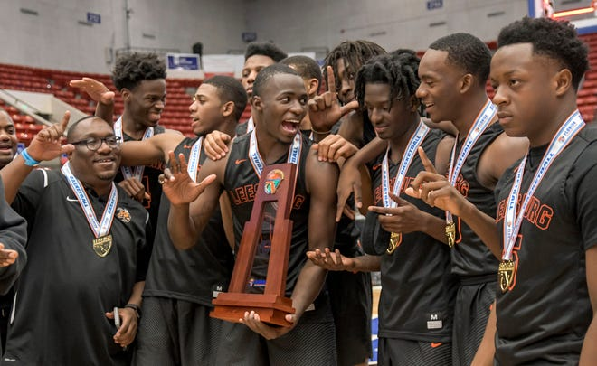 Leesburg celebrates after winning it's second straight state championship in 2018 at R.P. Funding Center in Lakeland. [PAUL RYAN /CORRESPONDENT]
