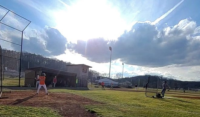 The Meadowbrook High baseball team took advantage of the nice weather on Monday afternoon  to get some practice out on the baseball diamond.