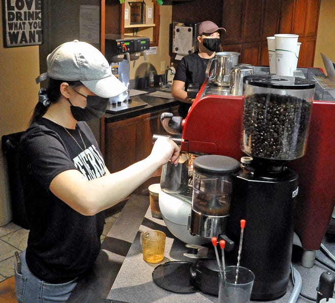 Maria Pagniano, a junior at Wooster High School, requested to move to remote learning in September. She thinks it's a better fit for her lifestyle because she is involved with travel volleyball and works at the Undergrounds Cafe & Coffee House. Here, Pagniano makes a drink for a customer.