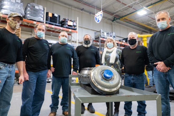 The production team at Schaeffler in Wooster stands with its 30 millionth torque converter.