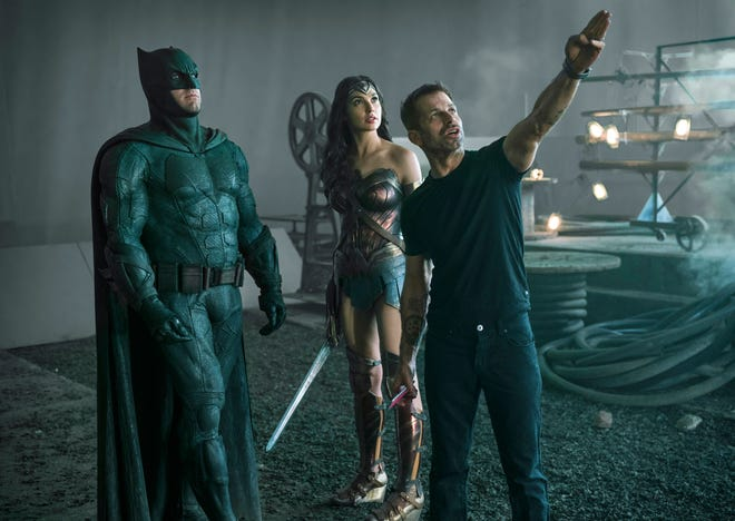 """From left, Ben Affleck as Batman, Gal Gadot as Wonder Woman and director Zack Snyder are seen on the set of """"Zack Snyder's Justice League."""""""