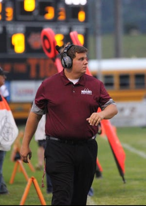 Morenci head football coach Stefan Wilkinson walks the sideline during a game as an assistant coach.