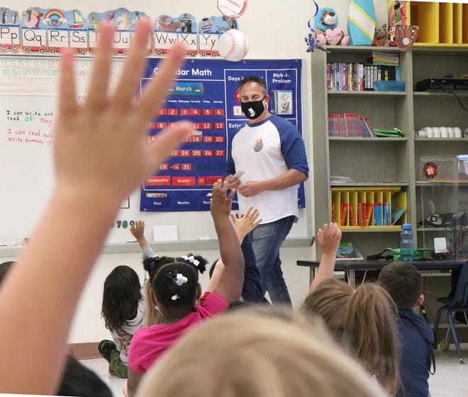 Students are eager to be called on in teacher Joseph Biggs' kindergarten class at R.J. Longstreet Elementary School in Daytona Beach. March 18, 2021.