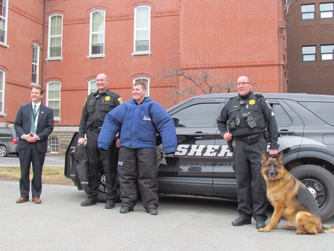 The Wayne County Drug Task Force recently donated a new bite suit and concealable bite sleeve to the county K9, Deputy Manfred. Pictured left to right, District Attorney A.G. Howell, Acting Sheriff Chris Rosler, Sheriff Deputy Nick Carozzi, Acting Sheriff Chief Deputy Ron Kominski, Deputy Manfred.