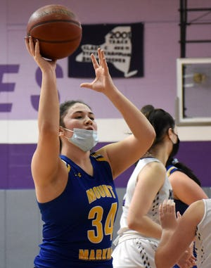 Zoe Hoke (34) grabs a rebound during the second half of Mt. Markham's game in Little Falls Saturday. Hoke scored six of her 10 points in overtime Wednesday to help Mt. Markham defeat West Canada Valley.