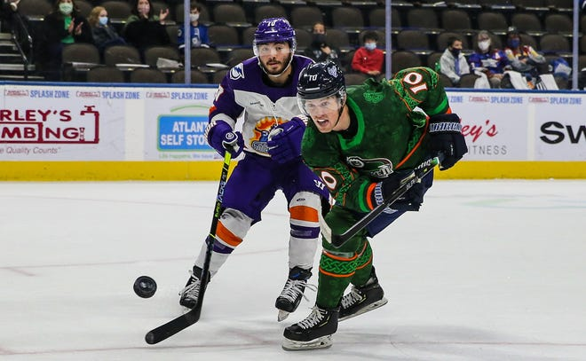 Icemen forward Christopher Brown (10), right, takes a shot in front of Solar Bears forward Joseph Garreffa during a March game.