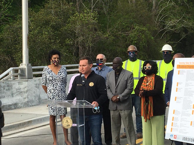 """Jacksonville Mayor Lenny Curry was joined by a half dozen City Council members Thursday as he made the case for a """"Jobs for Jax"""" program financing transportation projects by doubling the local gas tax."""