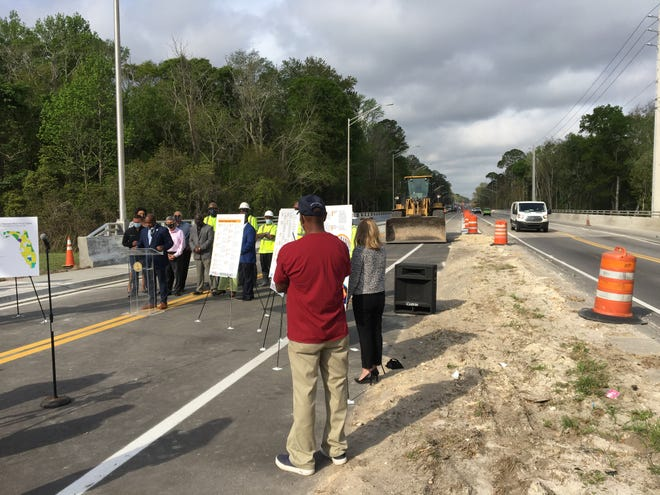 """Jacksonville Transportation Authority CEO Nat Ford speaks Thursday at a """"Jobs for Jax"""" event along a section of Collins Road being widened by JTA."""