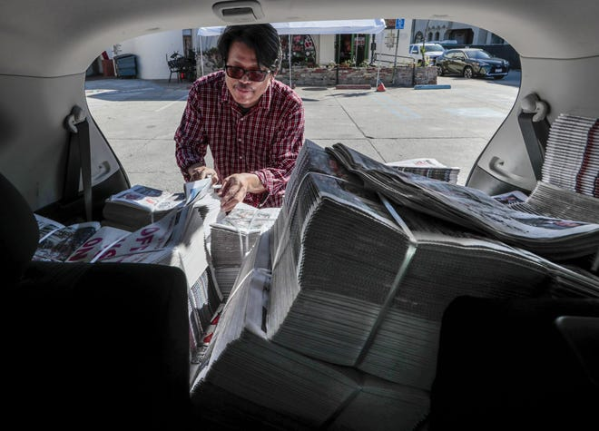 Thakhin Kai Bwor delivers the Myanmar Gazette from the back of his Nissan Rogue on Feb. 17, 2021 in Monterey Park, Ca. Bwor, a web security specialist by day, moonlights as the editor of the Gazette, the only Burmese-language newspaper in the U.S.