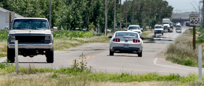 Motorists make their way along Jennie Barker Road south of Mary Street. Renovation plans, expanding it to four-lane from Schulman Avenue to Mary Street is underway through a portion of a sales tax initiative. The county commission is looking at extending the initiative.