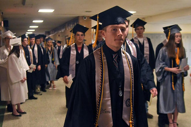 Galesburg High School graduates make their way to the Hegg Auditorium for the 2019 commencement program.