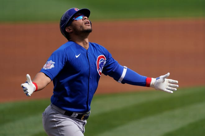 Chicago Cubs catcher Willson Contreras (40) celebrates after hitting a home run during the first inning of a spring training game against the Arizona Diamondbacks on Sunday, March 7, 2021, in Scottsdale, Ariz.