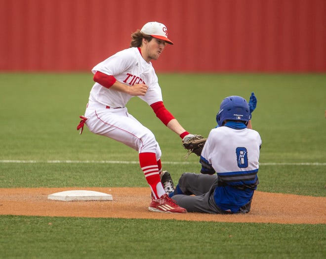 Glen Rose's Kanyon Keese (11) tags out a Ford runner at second base.