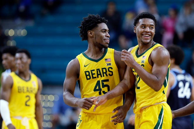 In this Nov. 24, 2019, file photo, Baylor guard Davion Mitchell (45) and guard Jared Butler (12) react late in the second half of an NCAA college basketball championship game against Villanova at the Myrtle Beach Invitational in Conway, S.C.