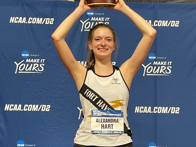 Fort Hays State high jumper Alexandra Hart holds up her national championship trophy last Friday at the Division II Indoor Track and Field Championship in Birmingham, Ala.