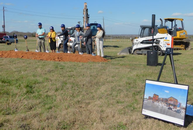 Denison city leaders held a groundbreaking ceremony Wednesday for a new travel station that will open in North Denison along U.S. Highway 75 and State Highway 91.