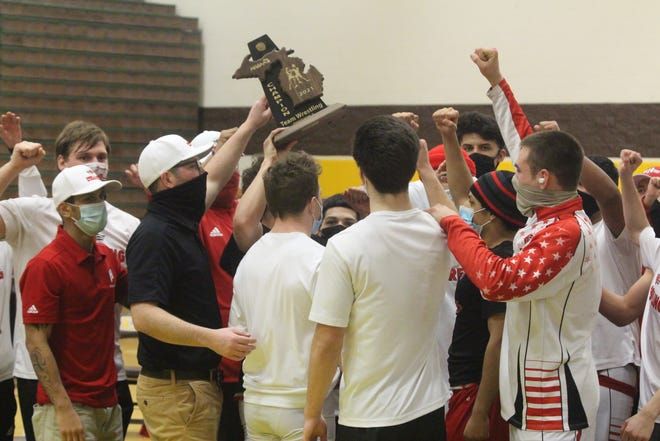 Holland wrestling won the district title, over Zeeland East, Zeeland West and Hamilton, for the third straight season on Wednesday, March 17, 2021