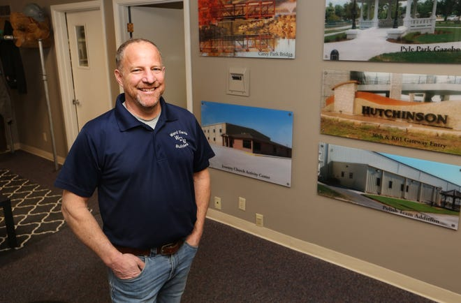 Ward Davis' construction company, Ward Davis Builders, has been chosen as the Hutchinson / Reno County Chamber of Commerce Small Business of the Month. Davis has photographs hanging in the office of the projects that his company has completed.