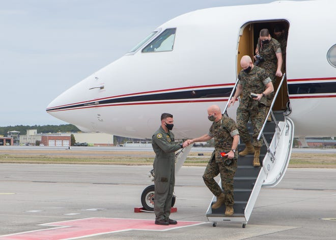 Commandant of the Marine Corps Gen. David H. Berger and Sgt. Maj. of the Marine Corps Sgt. Maj. Troy E. Black disembark an aircraft at Marine Corps Air Station Cherry Point, March 15.