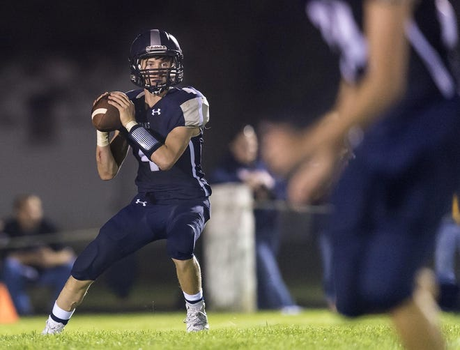 Annawan/Wethersfield quarterback Coltin Quagliano looks to pass during a 2019 high school football game.