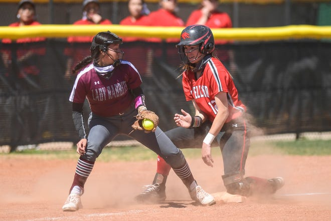 Levelland's Amber Kelly (12) slides safe ahead of the throw to Ralls' Leslie Torres (7) during a game on Thursday, March 18, 2021, in Levelland, Texas. [Justin Rex/For A-J Media]