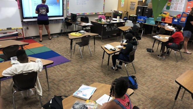 Students at Ervin Elementary School learn socially distanced and with face coverings during school.