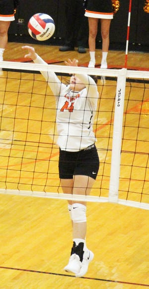 La Junta High School's Raini Tafoya puts the ball over the net in a match against Lamar in 2019. The Tigers open the season at Crowley County on Monday.