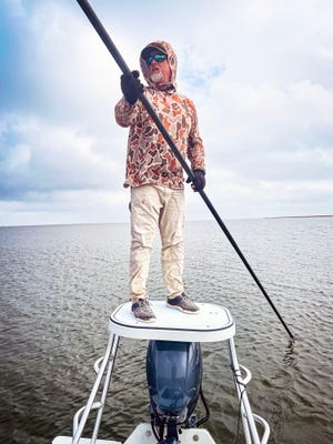Kevin Morlock searches for redfish in the marsh on the Gulf of Mexico in Louisiana.