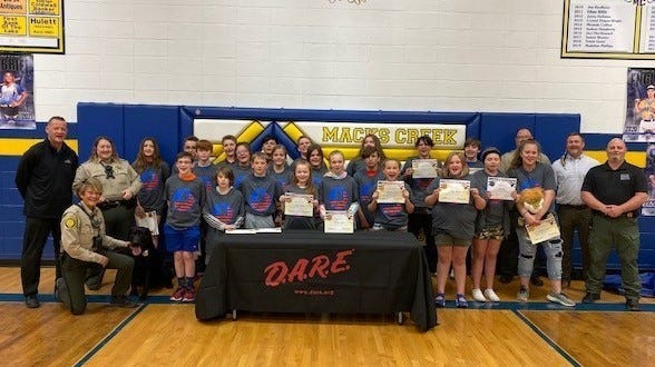 The entire DARE Graduating Class of 2021 with law enforcement officials, guests and K-9 Otis.