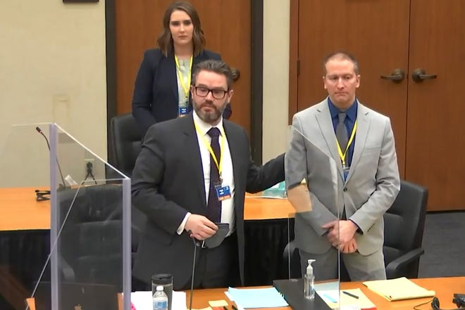 In this screen grab from video, defense attorney Eric Nelson, left, defendant and former Minneapolis police officer Derek Chauvin, right, and Nelson's assistant Amy Voss, back, introduce themselves to jurors as Hennepin County Judge PeterÊCahill presides over jury selection in the trial of Chauvin Wednesday, March 17, 2021 at the Hennepin County Courthouse in Minneapolis, Minn.  Chauvin is charged in the May 25, 2020 death of George Floyd.  (Court TV, via AP, Pool)