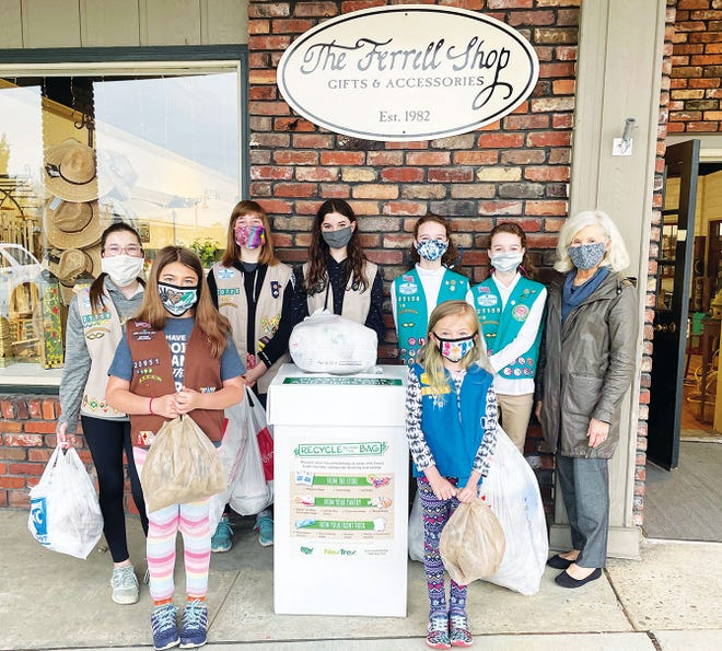 Oak Ridge Girl Scouts are helping Barbara Ferrell collect 500 pounds of plastic. Back row, from left, are Danielle Ellis, Ellie Jennings, Katelyn Mayes, Lindsey Faulkner, and Lily Faulkner, all of Troop 21158, and Barbara Ferrell. Front row, Alyssa and Julia Sacala of Troop 20951.