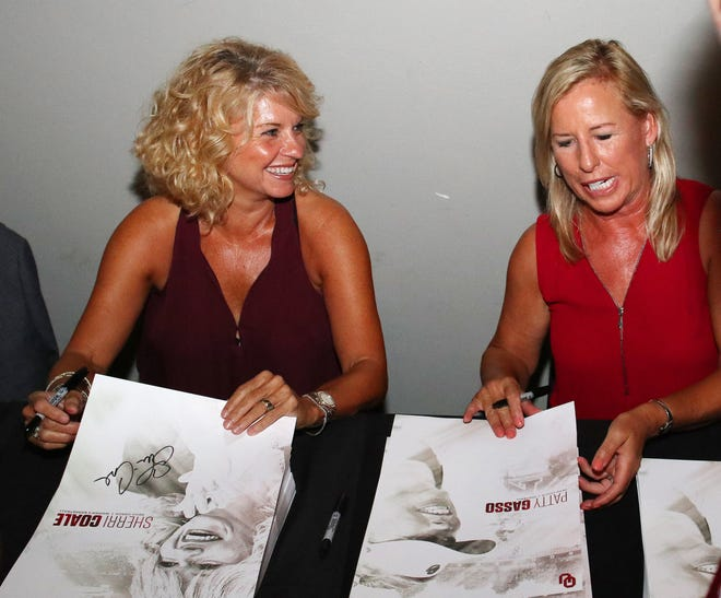 Sherri Coale and Patty Gasso sign posters during the 2017 OU Night of Champions in Oklahoma City. They built a pair of powerhouse programs over the past two decades, Coale with OU women's basketball and Gasso with OU softball.