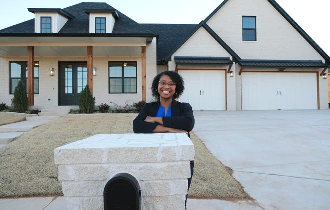 Dionne Carruthers stands outside a home she built in Oklahoma City.