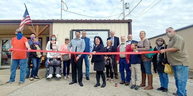 The Garnett Area Chamber of Commerce had a ribbon cutting ceremony Thursday for Strategic Financial Concepts Inc. at their new office location. Pictured left to right are James Kyle, Les Thomas, Lennet Thomas, Helen Norman, GACC Board Secretary, Mike Norman, Joyce Easterbrook, Jamison Brummel, Financial Advisor, Strategic Financial Concepts Inc., Dave Brummel, Kris Hix, GACC Executive Director, Cathy Brummel, Mike Truly, Senior Financial Advisor for Strategic Financial Concepts Inc., Gary Rommelfanger, Bruce Davison, Founder of Strategic Financial Concepts Inc., Jennifer Brummel, Justice Brummel, Mike Detwiler, and Cheryl Detwiler.
