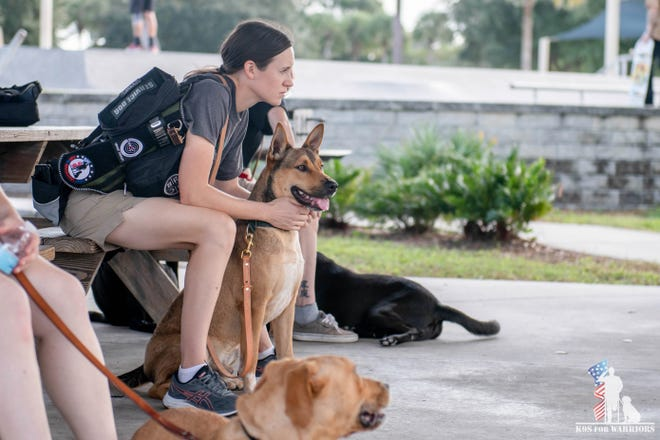 The Ann Norton Sculpture Gardens will raise funds  Saturday for the K9s for Warriors program, which helps veterans such as Sarah, who is shown with her dog, Major.