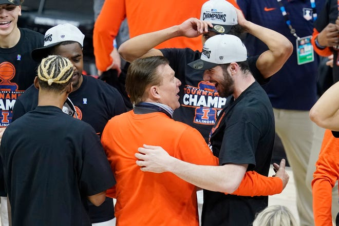 Illinois head coach Brad Underwood hugs Giorgi Bezhanishvili as they celebrate after Illinois defeated Ohio State in overtime of an NCAA college basketball championship game at the Big Ten Conference tournament, Sunday. Illinois won in overtime.