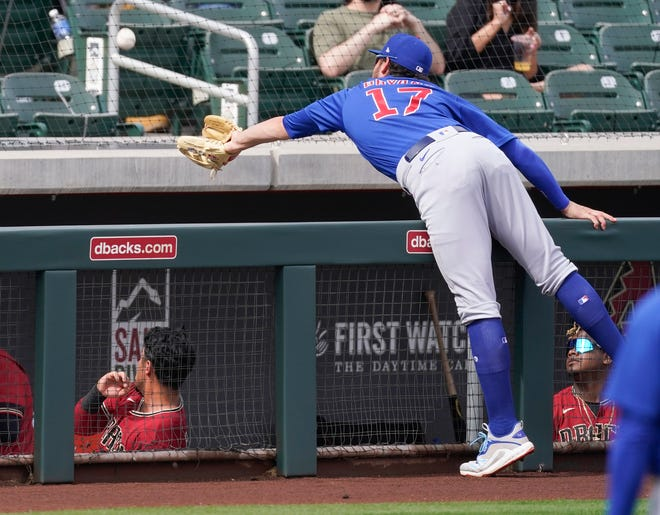 A foul ball hit by Arizona Diamondbacks' Christian Walker is out of reach for Chicago Cubs third baseman Luis Bryant (17) during a spring training baseball game in Scottsdale, Ariz.
