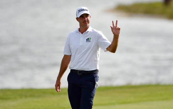 Chase Koepka acknowledges the hometown fans as he makes his way up the eighteenth fairway during the first round of the Honda Classic at PGA National Resort and Spa in Palm Beach Gardens, FL. Thursday, March 18, 2021.