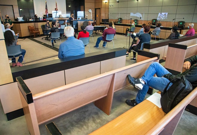 Potential jurors are spaced out around the courtroom as Judge Scott Suskauer presides over jury selection Thursday.