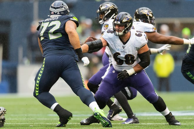 Former Baltimore Ravens center Matt Skura blocks Seattle Seahawks defensive tackle Al Woods. [STEVEN BISIG/USA TODAY Sports]