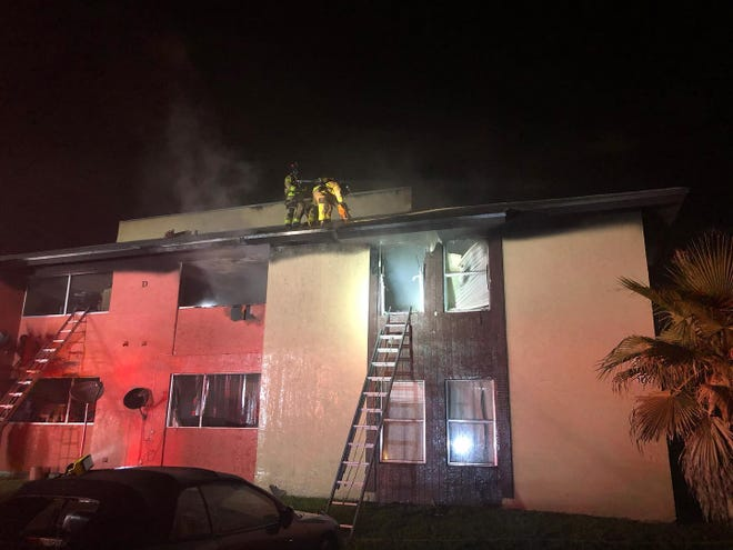 Crew battle a fire in the early morning hours of Thursday, March 18, 2021, at the Brandywine Apartments in suburban West Palm Beach.