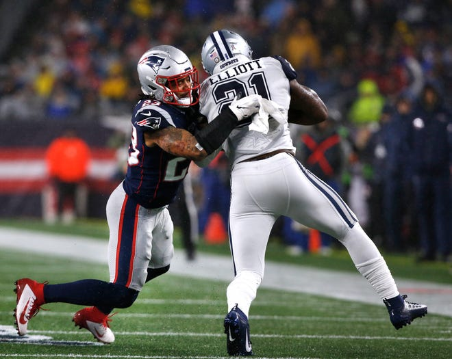 Patrick Chung grabs Cowboys running back Ezekiel Elliott in a 2019 game at Gillette Stadium. Chung announced his retirement Thursday after 11 NFL seasons.